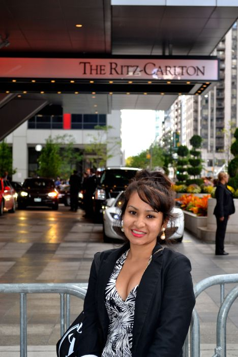 Standing in front of the Ritz-Carlton