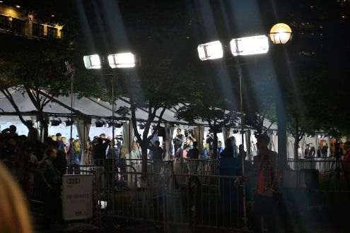 Fans and reporters eagerly await the perfect shot