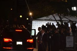 Kate Hudson about to step out of her SUV