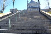 Grand stairs leading to a majestic building in New Montreal