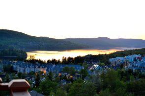 The sunset over the lake creates a breath taking orange glow, illuminating the waters