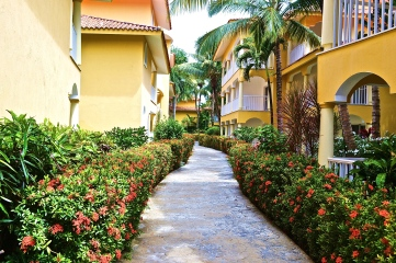 Flowered runway path leads to the pool and bar area. © Krystal Seecharan
