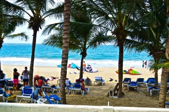 The ocean breeze cools off tourists as they relax on the sands. © Krystal Seecharan
