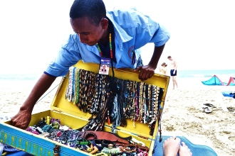 Panhandler making his daily rounds selling gorgeous hand made jewellery. © Krystal Seecharan