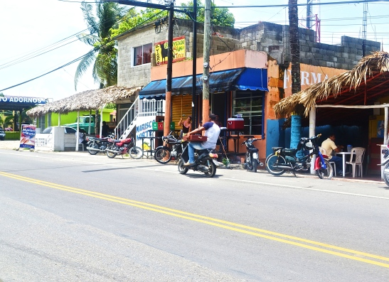 Local shops and scooters line the streets