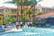 Staff at Viva Wyndham entertaining the guests at the pool © Krystal Seecharan