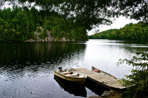 Small boats sandwiching the dock. (c) Krystal Seecharan