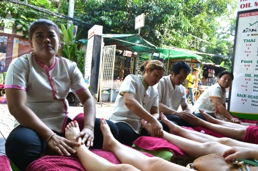 Enjoying a relaxing foot massage on the streets. (c) Krystal S.