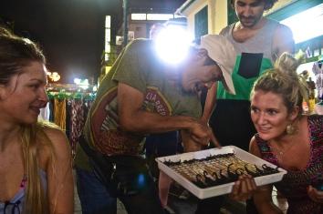 Locals offering scorpions (c) Krystal S.