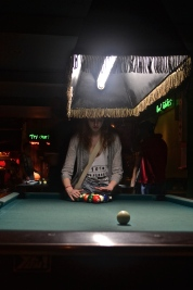 Enjoying a game of pool (c) Krystal S.