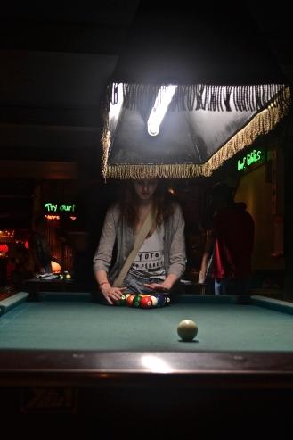 Enjoying a game of pool (c) Krystal S.