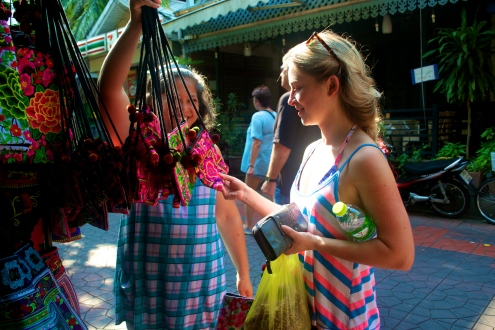 Tourist bargaining with local (c) Krystal S.